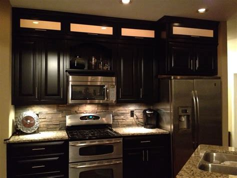 espresso kitchen cabinets with backsplash espresso cabinets light granite stacked rock backsplash
