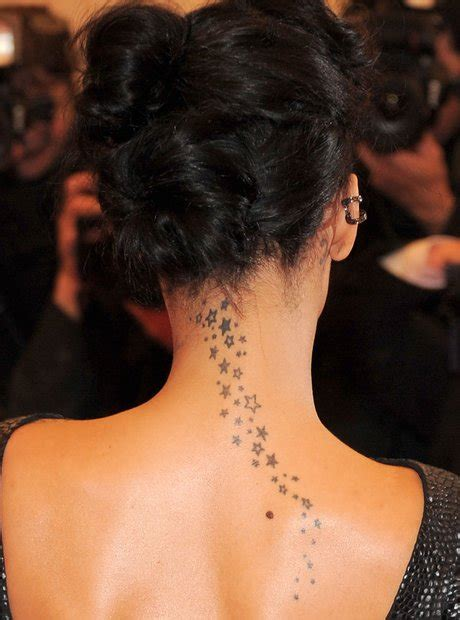 rihanna tattoo on her neck a guide to rihanna s tattoos her 25 inkings and what they