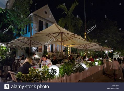 backyard restaurant key west young couple at an outdoor restaurant on duval sreet at