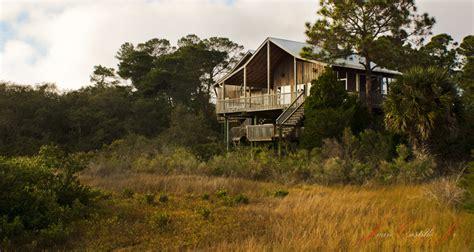 themes in the house behind the cedars little house on a prairie cedar key style windows to