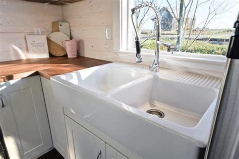 tiny house on wheels w big kitchen and sink vanity
