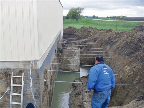 repairing straightening tilting foundation walls by