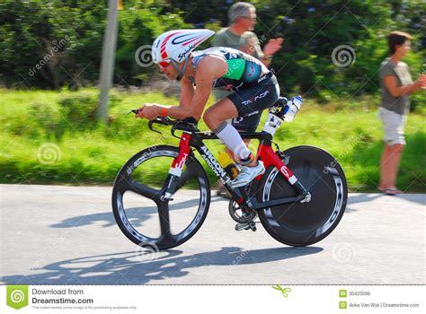 professional ironman triathlete cycling editorial photo