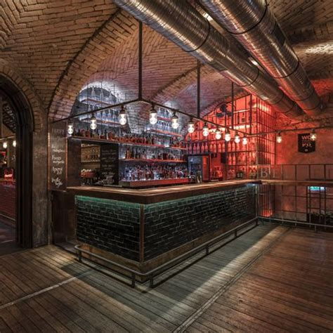 bar top lighting industrial bar exposed brick dark wood exposed vents