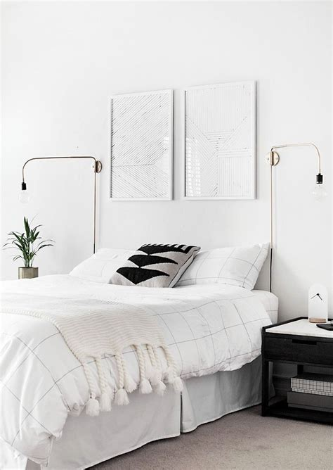 minimalist white bedroom  gold sconces inspiring
