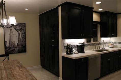 maple pantries stained black can see wood grain up
