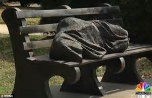 jesus on bench sculpture of jesus as a homeless person on bench divides