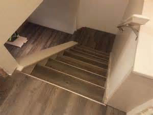 drop done luxury vinyl plank in eastern township with metal insert stair nosing project