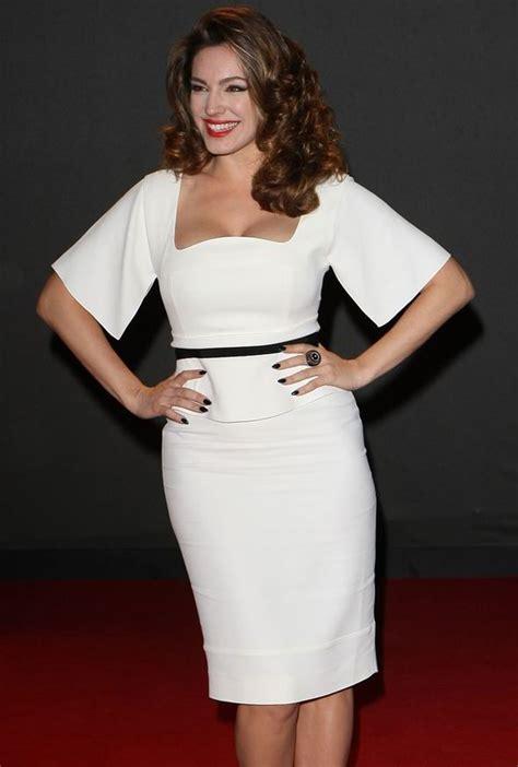 kohler tv commercial model in gown short dark hair kelly brook flaunts her curves in a figure hugging white
