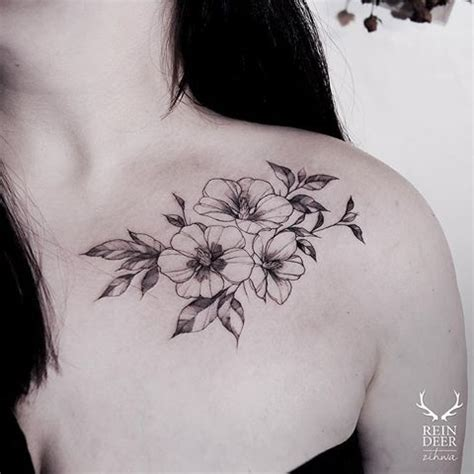 medium size blackwork style collarbone tattoo of little