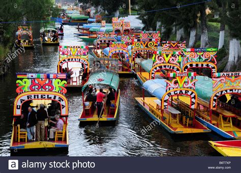 colourful boats of xochimilco mexico city stock photo - Floating Boats Mexico City