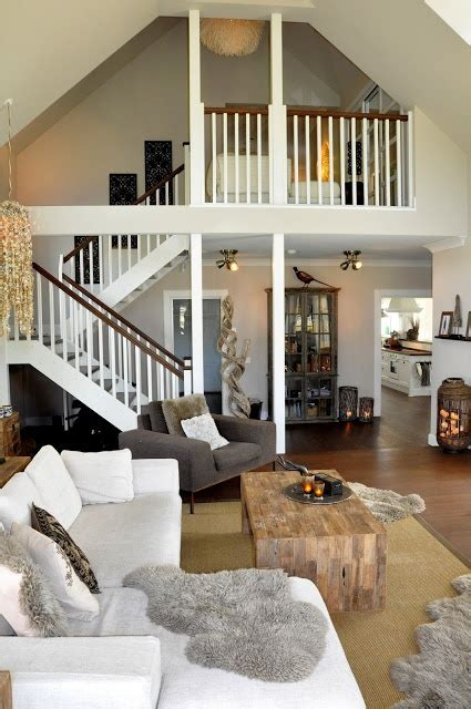 living room loft living room with loft overlooking it neutrals and