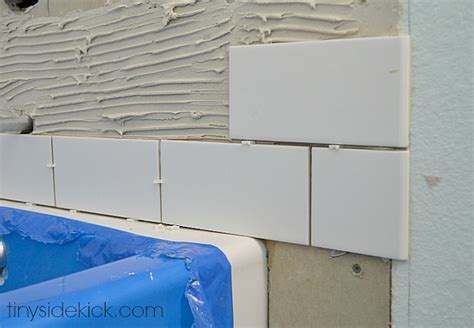 how to install bathtub tile how to tile a tub surround