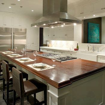 center island kitchen with stove fabulous gourmet kitchen features a ceiling mount vent