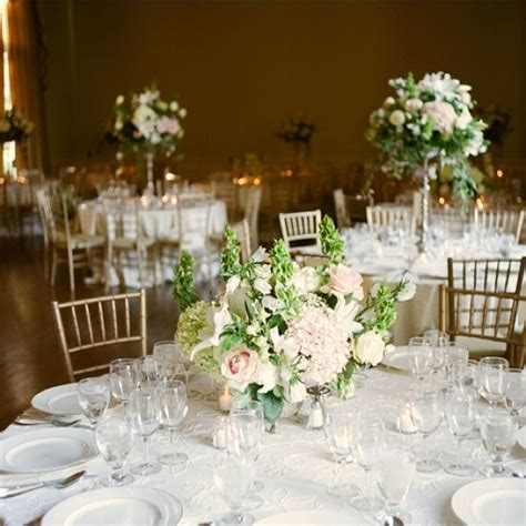gold and white and high and low centerpieces wedding