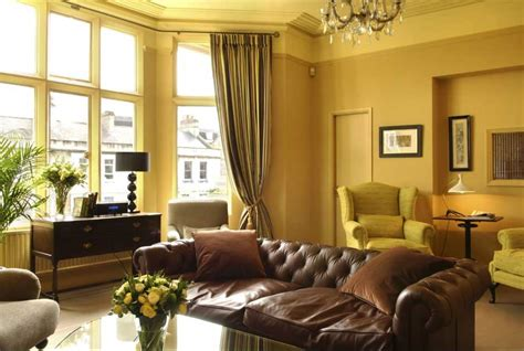 yellow paint colors for living room yellow gold paint color living room with brown sofa home