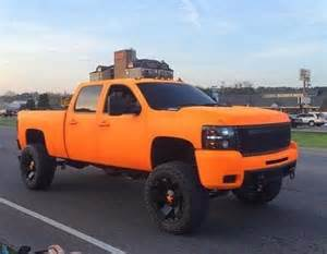 orange lifted chevrolet chev silverado truck this would be