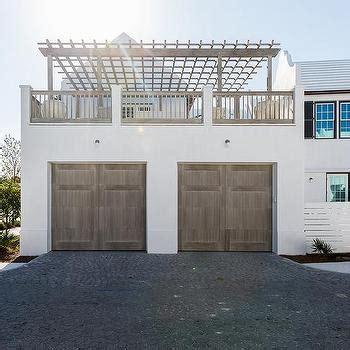 white brick home  black garage doors cottage home