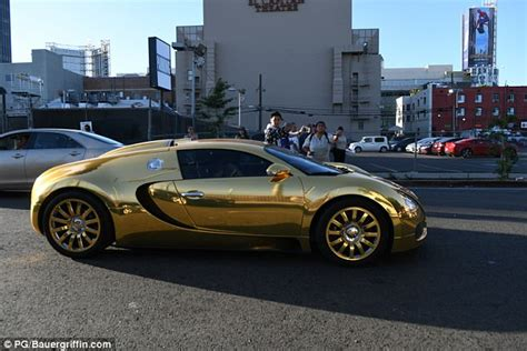car bugatti gold foxx pulls up to premiere in gold bugatti veyron