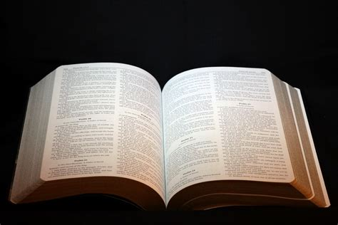 open bible and candle wallpaper