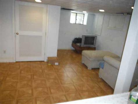 warm flooring for basement quality 1st basement systems basement finishing photo