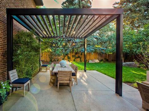 this cozy outdoor space features a custom designed pergola