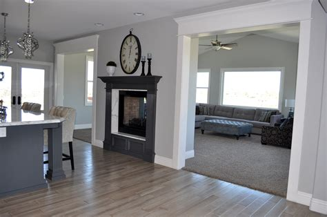 grey hardwood floors and double sided fireplace