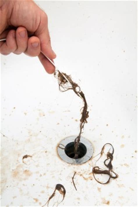 how to clean hair out of bathtub drain clearing a clogged bathtub drain thriftyfun