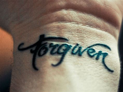 forgiven cross tattoo forgiveness on heartbreak