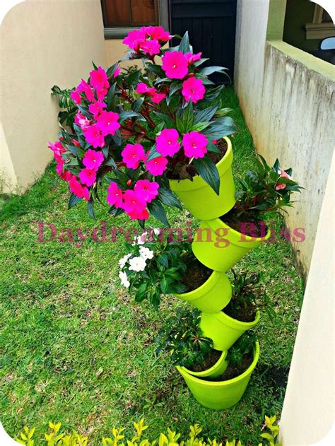 flower tower planter 25 best ideas about flower pot tower on stacked flower pots diy yard decor and