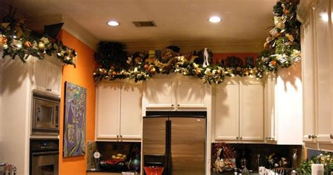 Garland For Above Kitchen Cabinets by The Cabinets Decorate It Right
