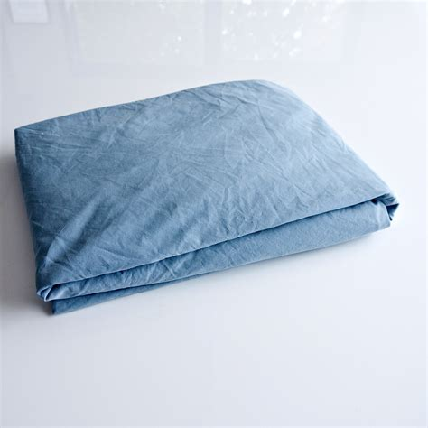 how to fold a fitted sheet popsugar smart living
