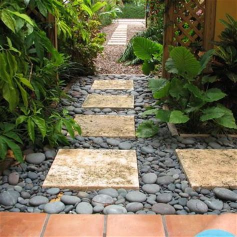 backyard pebbles tranquil path of pavers river rock and hostas this