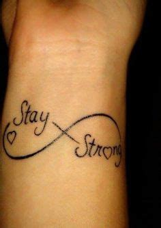 infinity tattoo times square infinity symbol feather tattoos and stay strong on pinterest