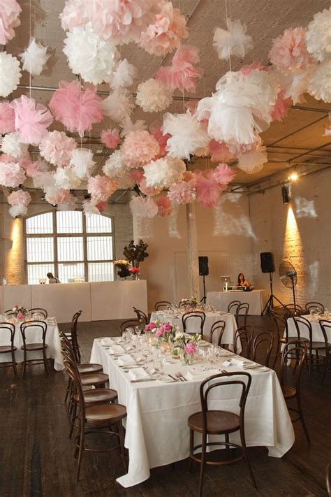 ceiling pom poms the ceiling can never many pom poms weddings