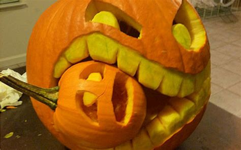 clever pumpkin halloween eating small pumpkin carving creative ads and