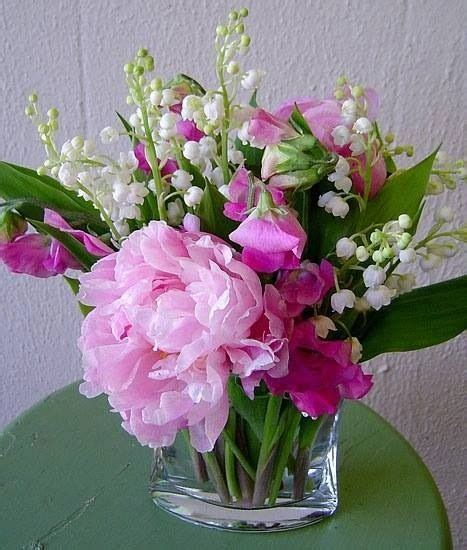 peas and peonies peonies sweet peas lily of the valley flowers