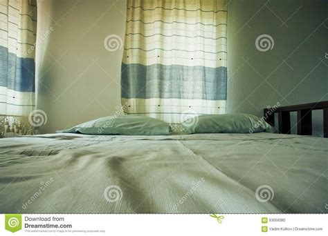 two pillows on bed stock photo image of domestic room two pillows on a comfortable bed of small cozy bedroom