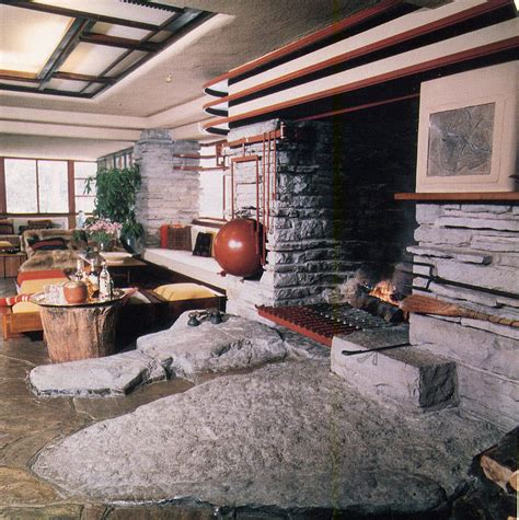 Falling Water Interior flr fallingwater fireplace and rock in front home