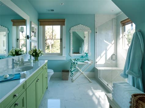 a turquoise wall color sets the for interior design in one of hgtv home s most
