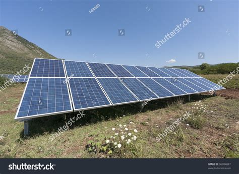 solar panels in a green field stock photo 96704887