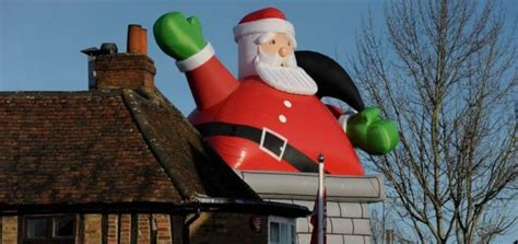 blow ho ho giant inflatable santa rips tiles off pub roof