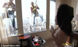 kendra wilkinson accidentally gives the window cleaners