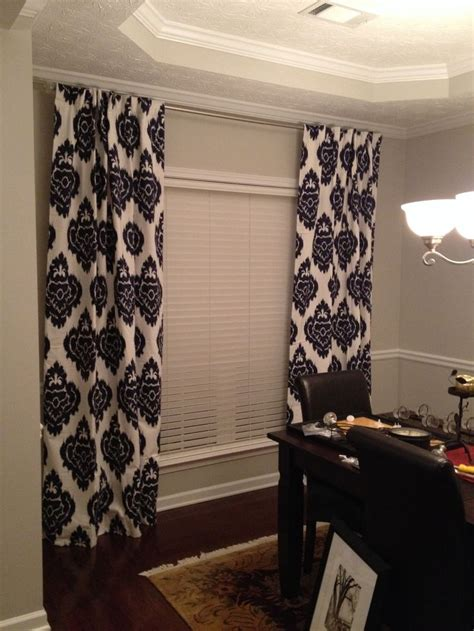 navy blue ikat curtains and sherwin williams repose gray paint in my dining home design