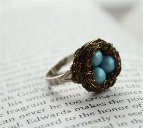 blue and brown wire blue and brown nest egg wire wrapped adjustable ring