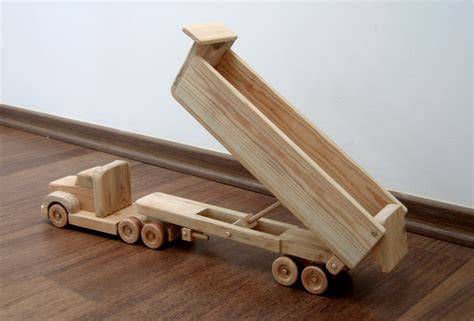 wooden truck toy daphne the dump truck a wooden toy with movable bed