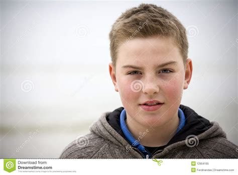 handsome teenage boy royalty free stock images image young handsome boy with pullover at beach winter royalty