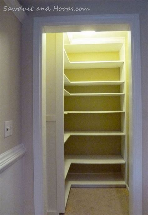 closet with adjustable shelves and crown molding