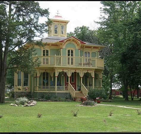 houses with big porches i big front porches like this and the tower widow s walk at the top is beautiful a