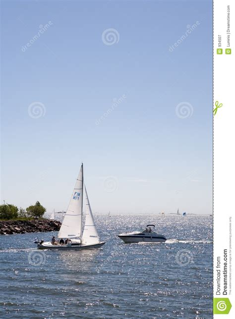 motorboat or sailboat sailboat vs motorboat royalty free stock photography